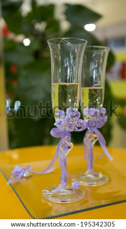 Glasses with champagne bridal wedding day - stock photo