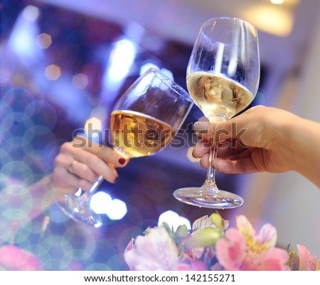 Glasses with champagne in hand. - stock photo