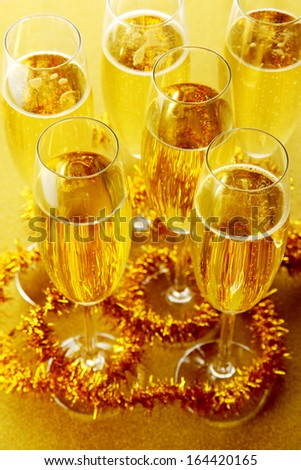 Glasses with champagne on shiny background