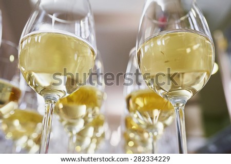 glasses with Champagne on white table - stock photo