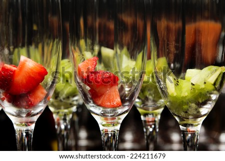 Glasses with drinks  kiwi strawberry - stock photo