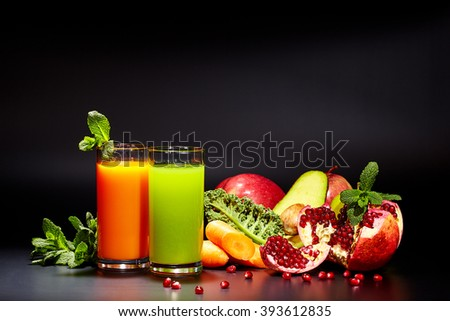 Glasses with fresh vegetable juices isolated on black. Detox diet. - stock photo