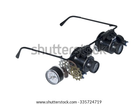 Glasses with gears and gauge and lights for magnifying small items - path included - stock photo