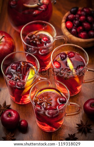 Glasses with hot punch for winter and Christmas with fruits and wine - stock photo