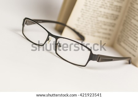 Glasses with open book