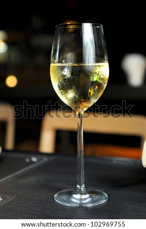 glasses with white wine - stock photo