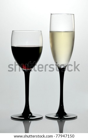 Glasses with wine and champagne isolated in a studio