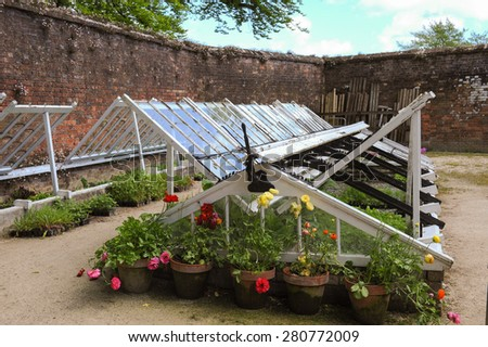 Glasshouse in a Walled Garden at the Lost Gardens of Heligan, Cornwall, England, UK - stock photo