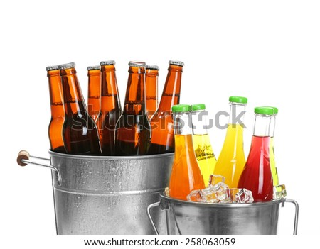 Glassware of different drinks in metal buckets isolated on white - stock photo