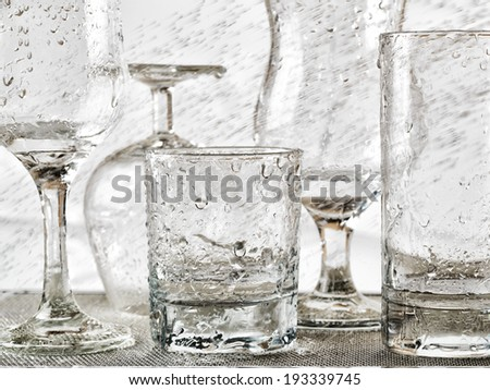 Glassware washing under water jets. - stock photo
