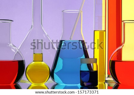 Glasswares in chemical laboratory - stock photo