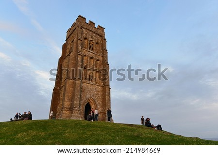 GLASTONBURY - AUG 30: View of Glastonbury Tor bathed in warm evening sunlight on Aug 30, 2014 in Glastonbury, UK. The Tor is a popular travel destination and cited as the legendary Isle of Avalon.