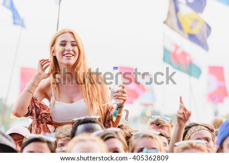 Glastonbury, Somerset, UK - June 27, 2015 - Festival goer enjoying Ben Howard playing Glastonbury Festival's Other Stage - stock photo