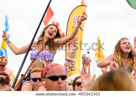 Glastonbury, Somerset, UK - June 27, 2015 - Festival goer enjoying George Ezra playing Glastonbury Festival's Pyramid Stage
