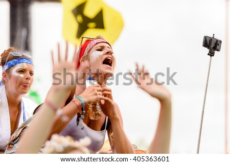 Glastonbury, Somerset, UK - June 27, 2015 - Festival goer enjoying George Ezra playing Glastonbury Festival's Pyramid Stage - stock photo