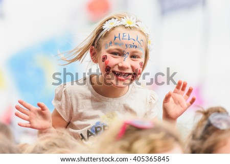 Glastonbury, Somerset, UK - June 28, 2015 - Young festival goer enjoying Lionel Richie playing Glastonbury Festival's Pyramid Stage - stock photo