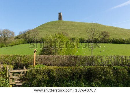 Glastonbury Tor, Somerset, England, which features the roofless St. Michael's Tower. It is a Scheduled Ancient Monument at the location believed by some to be the Avalon of King Arthur legend.