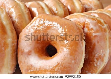Glazed donut background image.  Macro with shallow dof. - stock photo