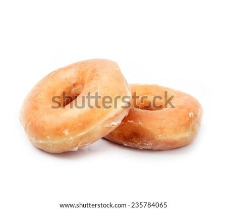 Glazed Donut with Bite Missing Isolated on white Background - stock photo