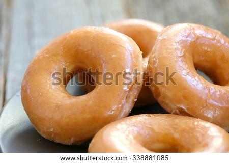Glazed donuts background image. Macro with shallow dof. - stock photo