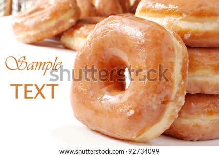 Glazed donuts on white background with copy space.  Macro with shallow dof. - stock photo