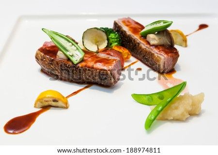 Glazed duck fillet, mashed potatoes seasoned with truffle oil, fig and aniseed sauce - stock photo