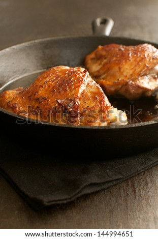 Glazed fried chicken or turkey in pan - stock photo