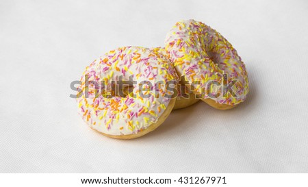 Glazed hot donuts. Sweet dish for tea. The dessert of donuts for Breakfast. Tasty food cakes. Delicious classic cakes: fried doughnuts glazed with caramel. Nutritious dish that promotes obesity. - stock photo