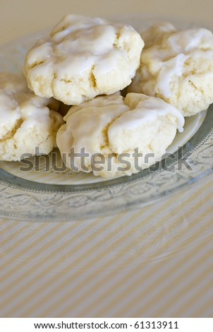 Glazed Italian Anise Cookies on a Plate - stock photo