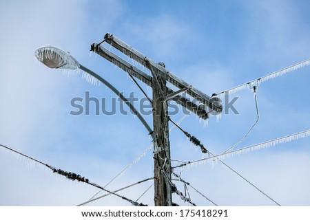 Glazed Power Line Utility Pole Electric Line from Winter Ice Snow Storm, Icicles - stock photo