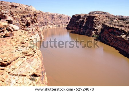 Glen Canyon Recreation Area in Utah has views of Colorado River and Lake Powell with a landscape dotted with colorful and unusual rock formations - stock photo