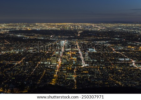 Glendale and downtown Los Angeles aerial night view. - stock photo