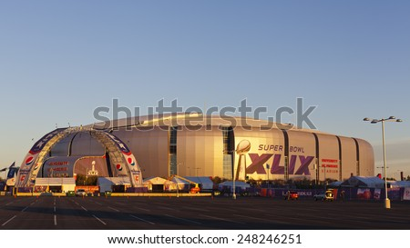 GLENDALE, AZ - JANUARY 24, 2015: Gold evening color cast on silver dome of University of Phoenix Arizona Cardinal Stadium that dressed up for Super Bowl XLIX taking place on  February 1, 2015 - stock photo