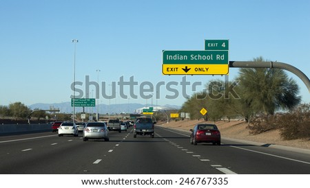 GLENDALE, AZ - JANUARY 24, 2015: North bound traffic on Loop-101 toward University of Phoenix Cardinal Stadium where New England Patriots play Seattle Seahawks during Super Bowl 49 on February 1, 2015 - stock photo