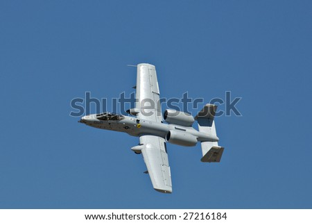 """GLENDALE, AZ - MARCH 21: A U.S. Air Force A-10 Thunderbolt banks a turn at the biennial air show (""""Thunder in the Desert"""") at Luke Air Force Base on March 21, 2009 in Glendale, AZ. - stock photo"""