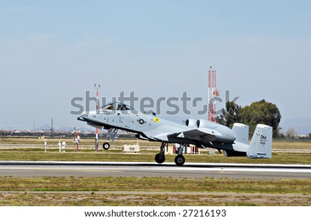 """GLENDALE, AZ - MARCH 21: A U.S. Air Force A-10 Thunderbolt lands on the runway at the biennial air show (""""Thunder in the Desert"""") at Luke Air Force Base on March 21, 2009 in Glendale, AZ. - stock photo"""