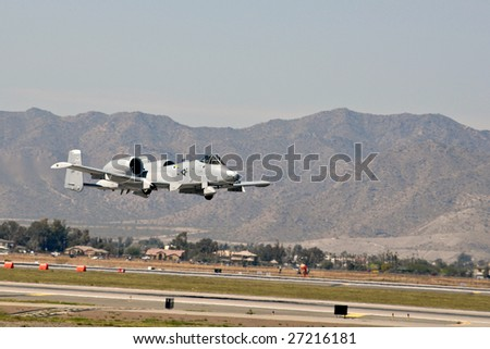 "GLENDALE, AZ - MARCH 21: A U.S. Air Force A-10 Thunderbolt makes a low altitude pass at the biennial air show (""Thunder in the Desert"") at Luke Air Force Base on March 21, 2009 in Glendale, AZ."