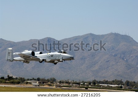 """GLENDALE, AZ - MARCH 21: A U.S. Air Force A-10 Thunderbolt makes a low altitude pass at the biennial air show (""""Thunder in the Desert"""") at Luke Air Force Base on March 21, 2009 in Glendale, AZ. - stock photo"""