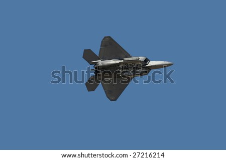 """GLENDALE, AZ - MARCH 21: A U.S. Air Force F-22 Raptor makes a pass with its bomb bay open at the biennial air show (""""Thunder in the Desert"""") at Luke Air Force Base on March 21, 2009 in Glendale, AZ. - stock photo"""