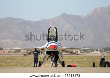 """GLENDALE, AZ - MARCH 21: A U.S. Air Force Thunderbird F-16 on the runway at the biennial air show (""""Thunder in the Desert"""") at Luke Air Force Base on March 21, 2009 in Glendale, AZ. - stock photo"""