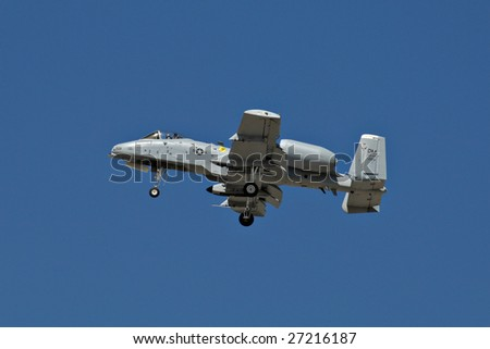 """GLENDALE, AZ - MARCH 21: Air Force A-10 Thunderbolt makes a pass with landing gear down at the biennial air show (""""Thunder in the Desert"""") at Luke Air Force Base on March 21, 2009 in Glendale, AZ. - stock photo"""
