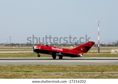 """GLENDALE, AZ - MARCH 21: Bill Reesman lands a Russian MiG-17 at the biennial air show (""""Thunder in the Desert"""") at Luke Air Force Base on March 21, 2009 in Glendale, AZ. - stock photo"""