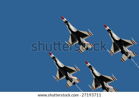 """GLENDALE, AZ - MARCH 21: The Air Force Thunderbirds perform at the biennial air show and open house (""""Thunder in the Desert"""") at Luke Air Force Base on March 21, 2009 in Glendale, AZ. - stock photo"""