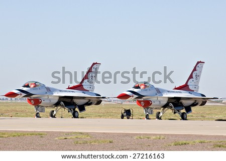 """GLENDALE, AZ - MARCH 21: Two U.S. Air Force Thunderbird F-16 aircraft on the runway at the biennial air show (""""Thunder in the Desert"""") at Luke Air Force Base on March 21, 2009 in Glendale, AZ. - stock photo"""