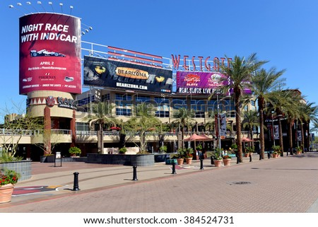 GLENDALE, AZ, USA - FEB 25, 2016:  A portion of the central court of the Westgate Entertainment District which houses the Gila River Arena, home of the NHL team the Arizona Coyotes - stock photo