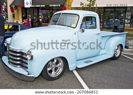 GLENDALE/CALIFORNIA - JULY 19, 2014: 1949 Chevy 3100 Pick Up Truck owned by Rick Kangraga at the Glendale Cruise Nights Car Show July 19, 2014 Glendale, California USA  - stock photo