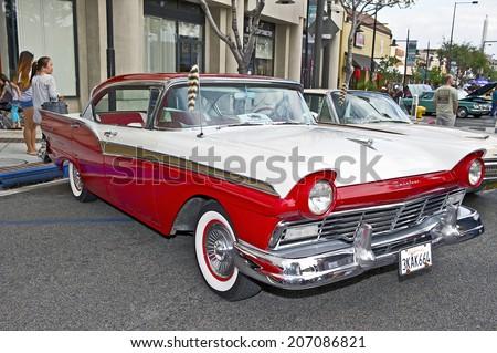 GLENDALE/CALIFORNIA - JULY 19, 2014: 1957 Ford Fairlane owned by Laurel & Joe Garcia at the Glendale Cruise Nights Car Show July 19, 2014 Glendale, California USA  - stock photo