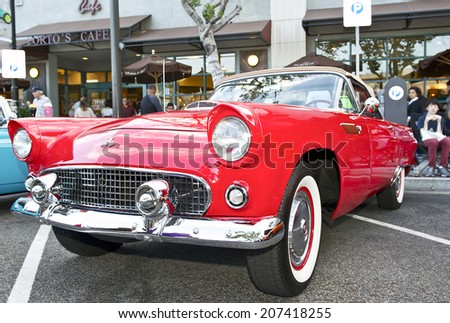 GLENDALE/CALIFORNIA - JULY 19, 2014: 1955 Ford Thunderbird owned by Enrique Blane at the Glendale Cruise Nights Car Show July 19, 2014 Glendale, California USA