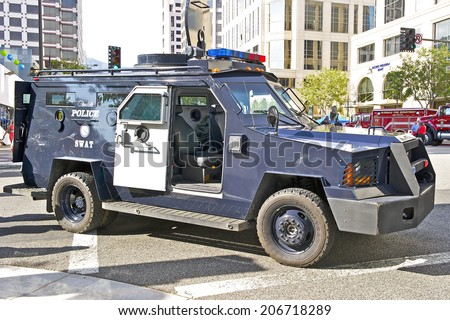 GLENDALE/CALIFORNIA - JULY 19, 2014: Glendale California, Police Department Swat Vehicle on display at the Glendale Cruise Nights Car Show July 19, 2014 Glendale, California USA  - stock photo