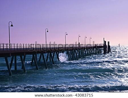 Glenelg pier at sunset - stock photo
